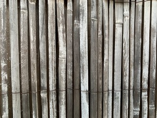 Vertical Wooden Slat Fence Texture with Faded White Paint