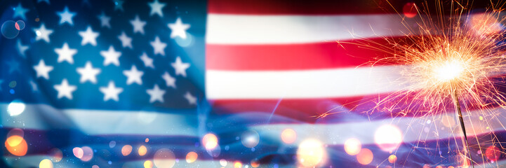 Close-up Of Sparkler With Bokeh And Smoke On American Flag Background - Independence Day Celebration Concept