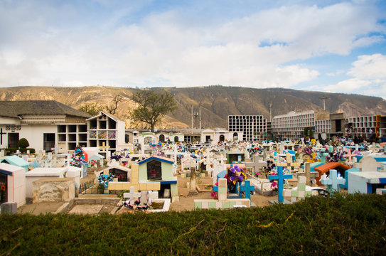 QUITO, ECUADOR- MAY 23, 2017: View of cemetery San Antonio de Pichincha, showing typical catholic graves with large gravestones, mountain background