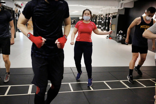 Students of a martial arts center train while wearing surgical masks to protect themselves from the coronavirus disease (COVID-19) in Taipei