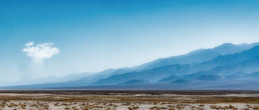 Beautiful open field with Sierra Nevada Mountain Range in California, USA