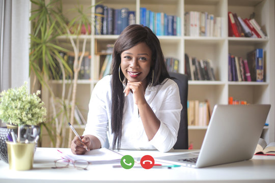 Cheerful woman having a business video call