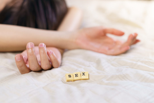 Woman hand sign relax on bed with alphabet showing words sex.