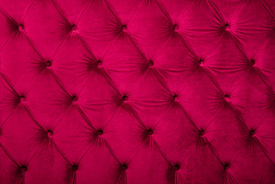 Full Frame Image Of Red Chesterfield Sofa