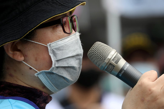 A labour union group leader speaks at a May Day rally while wearing a surgical mask to protect herself from the coronavirus disease (COVID-19) in Taipei