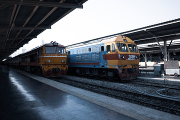 diesel locomotive train stop at public station. old railway station with trains and railway. vintage transportation