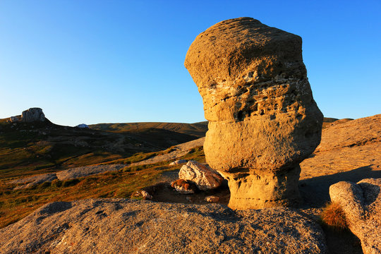 Rock Formation Against Clear Blue Sky At Bucegi Natural Park