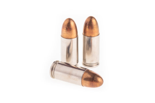 A group of 9mm bullets isolated on a white background