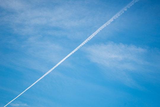 Vapor Trail In Blue Sky