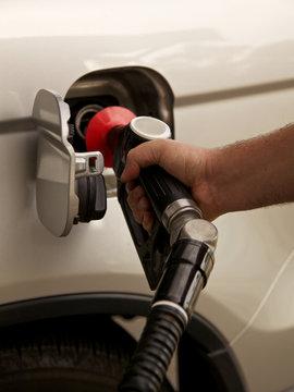 Cropped Image Of Man Filling Petrol Tank On Car