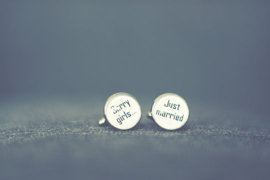 Close-up Of Text On Cuff Links
