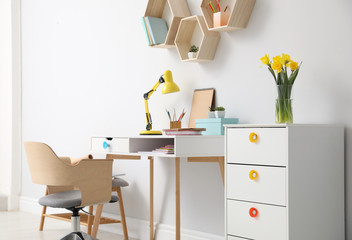 Comfortable workplace with wooden furniture and lamp Fotobehang