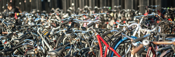 Poster de jardin Velo Group of a lot of old holland vintage classic bicycles row parked at parking station in public. Cityscape view. Dutch lifestyle