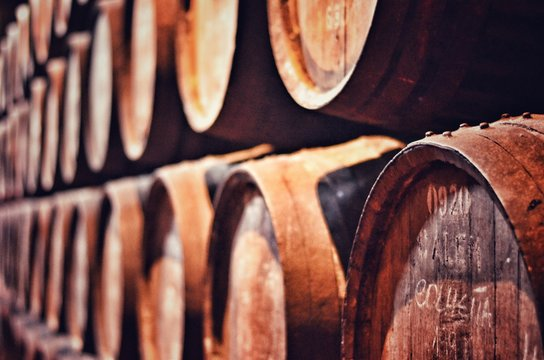 Wooden Wine Casks Arranged In Cellar
