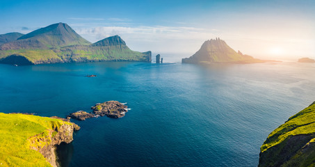 Spoed Fotobehang Noord Europa View from flying drone. Magnificent summer scene of Faroe Islands and Tindholmur cliffs on background. Spectacular morning view of Vagar island, Denmark, Europe. Traveling concept background.