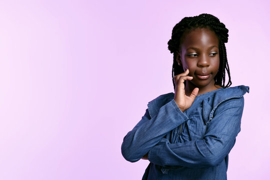Young black girl in denim dress