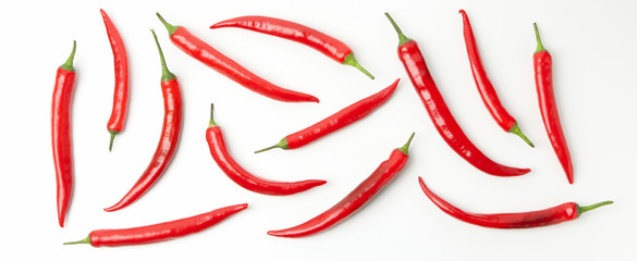 Flat lay with chilli peppers isolated on white background