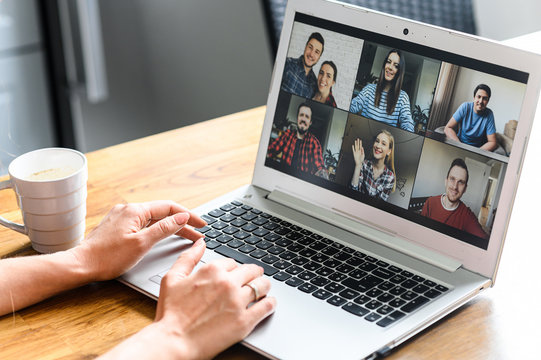 Video call, zoom. Icons of a group of people on laptop screen, app for video online communication. Female hands on the keyboard