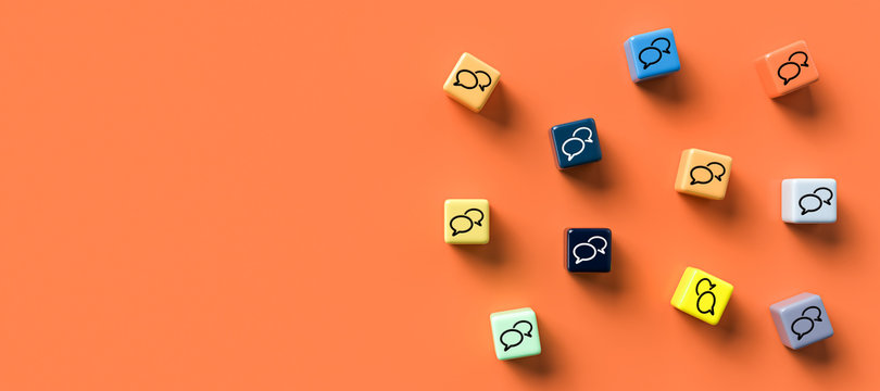 many cubes with speech bubble icons on orange background