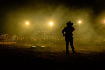 Photo sur Toile Brésil Rodeo workers from Brazil. Announcer calls to the crowd during rodeo show at an arena in Brazil.