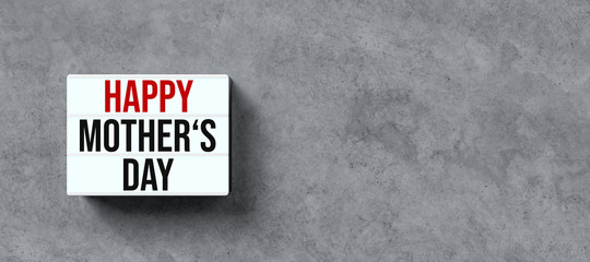 lightbox with message HAPPY MOTHER'S DAY on concrete background