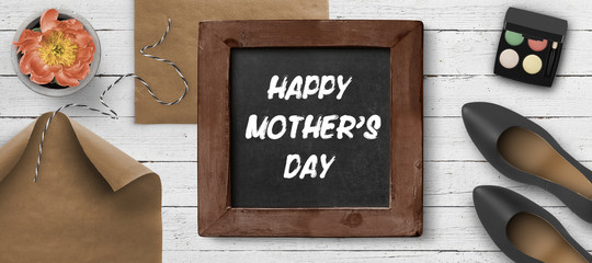 blackboard with message HAPPY MOTHER'S DAY on white painted wooden background