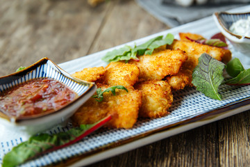 Appetizer deep fried chicken nuggets with sauce