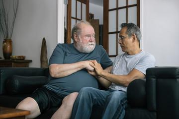 Senior Gay Couple Having Serious Conversation of a Problem