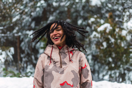 Cheerful woman having fun in deep snow