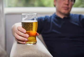 Man holding a pint of beer