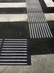 lines on asphalt road with markings for blind people