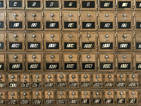 Close up of vintage post office mailboxes