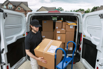 Shipment: Man Getting Boxes Out Of Delivery Van