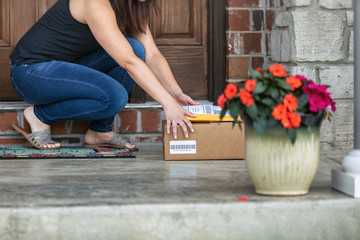 Shipment: Woman Finds Delivery Outside Door