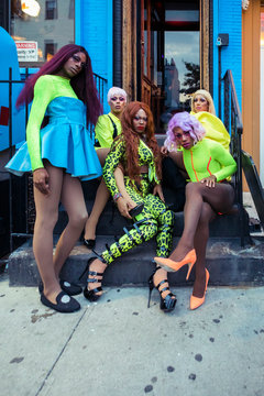 Portrait of drag queens in neon clothes