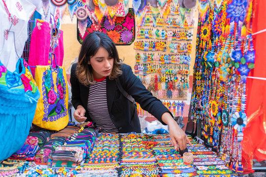woman choosing souvenirs