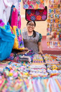 Nahuatl woman at her market stand, Mexico