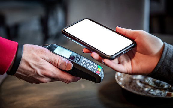 Contactless mobile payment. Mobile payment in cafe with smart phone nfc near field communication wireless technology