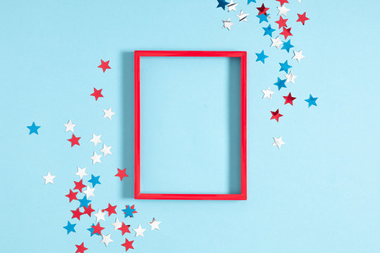 4th of July American Independence Day. Happy Independence Day. Red, blue and white star confetti, decorations on blue background. Flat lay, top view, copy space