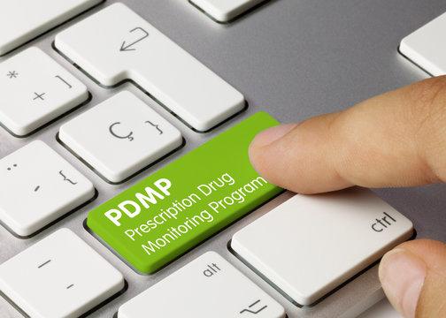 PDMP Prescription Drug Monitoring Program - Inscription on Green Keyboard Key.