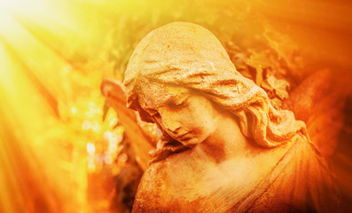 Fotomurales - Beautiful sad angel in direct sunlight. Vintage styled image of ancient statue.(religion, faith, death, resurrection, eternity concept)