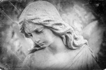 Fotomurales - Black and white image of angel in the sunlight (antique statue)