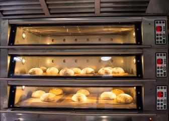 Zelfklevend Fotobehang Brood Rustic bread in the oven baking