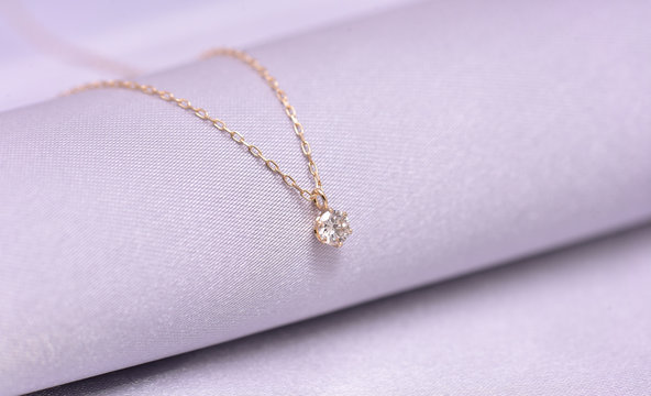 diamond necklace on a silk background