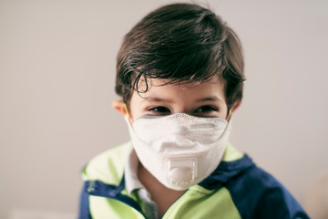 four years old boy with facial mask portrait