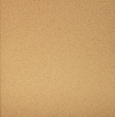 Beige plaster on the wall