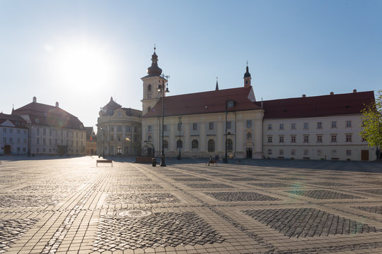 Great Square in Sibiu - Catholic Church and City Hall seen on a beautiful spring afternoon.