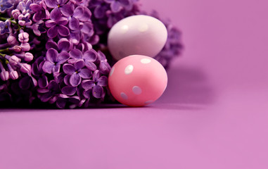 Beautiful Easter decoration with lilac and eggs stock images. Syringa with easter eggs stock images. Easter decoration on a purple background. Spring decoration images. Lilac flower frame stock images