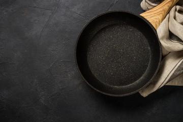 Frying pan or skillet on black table.