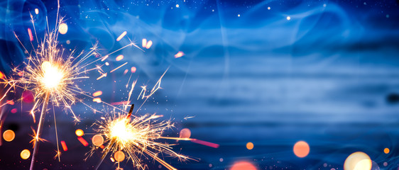 Sparklers With Smoke And Bokeh On Wooden Background - Independence Day Celebration Concept Wall mural